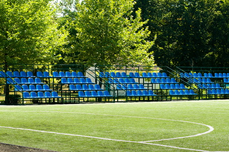 small football field with bleachers on a summer day Stock Photo