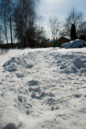 path in the snow to the house in winter Stock Photo