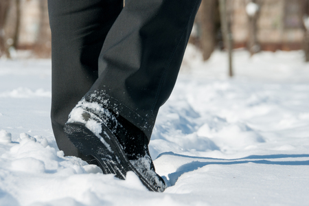 winter shoes with black pants in snow Stock Photo
