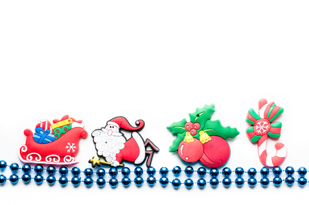 blue beads on a white background with Christmas toys Stock Photo