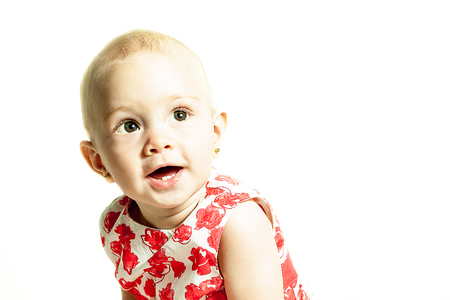 portrait of a young child on a white background Stock Photo