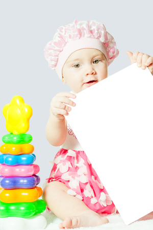 little girl sitting in a book indoors Stock Photo