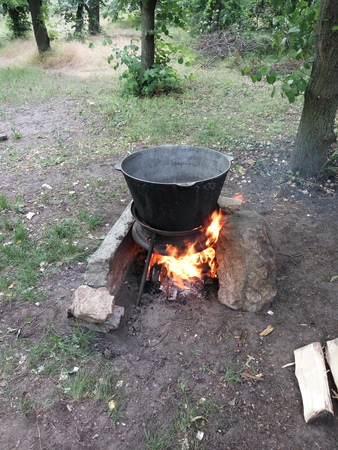 a large cauldron on a caste in the open air Stock Photo
