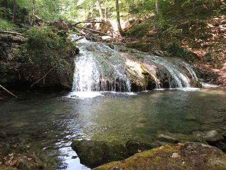 beautiful waterfall in the forest on a bright summer day