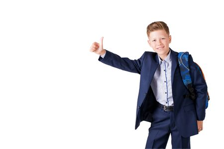boy in suit and school backpack over white background Stock Photo