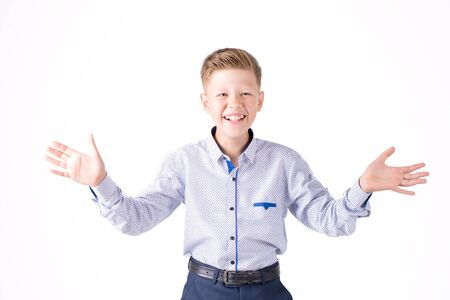 cheerful boy in a shirt on a white background and hands aside