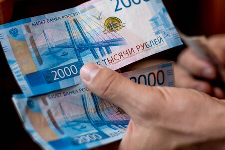 Russian money two banknotes of two thousand rubles in the hands