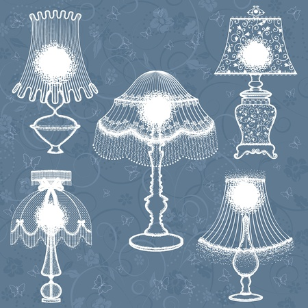 tabletop: Collection of abstract delicate lamps above floral blue background