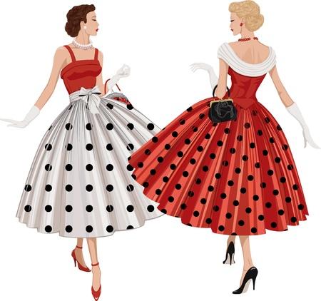 두 개의 우아한 여성 물방울 무늬 옷을 입고 갈색 머리와 금발의 의복은 서로 전달하여 검사