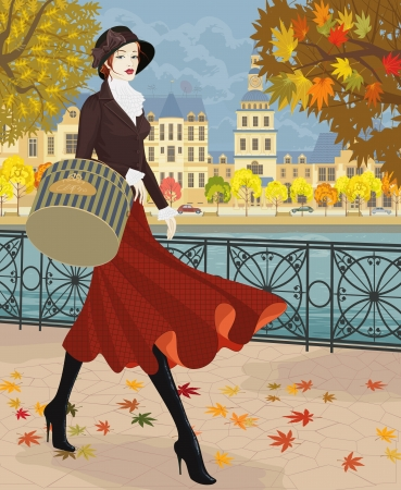 Beautiful young woman walking along embankment in autumn city