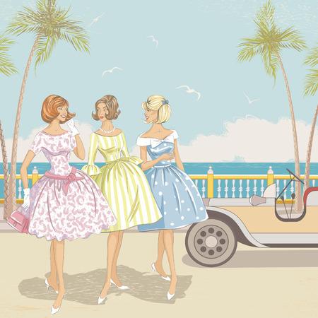 Drei elegante Frauen zu Fuß in der Nähe des Strandes