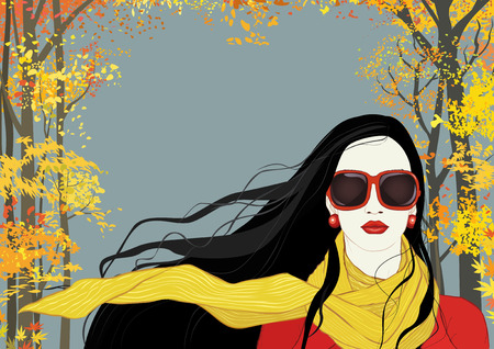 beautiful brunette: Portrait of a brunette woman with long flying in the wind hair on background with autumn trees