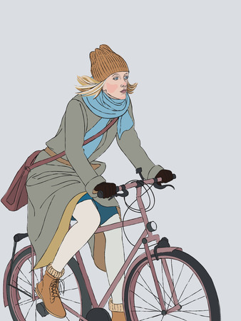 A young woman in winter clothes rides a bicycle