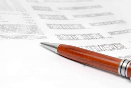 tabulation: wood pen on white documents with black print Stock Photo