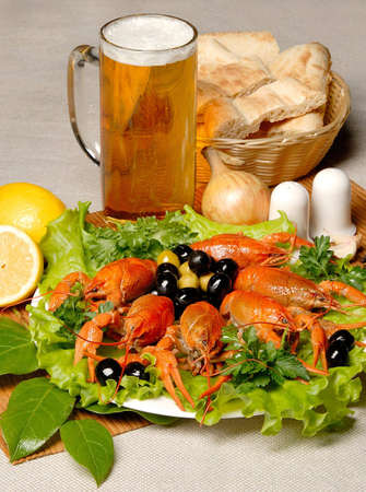plateful: beer and cancer on the white plate with green salad and lemon