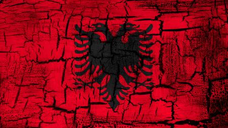 albanian: Flag of Albania, Albanian flag painted on cracked ground