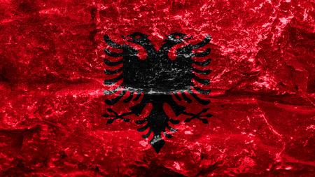 albanian: Flag of Albania, Albanian flag painted on stone Stock Photo