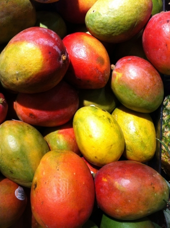 ripe: fresh ripe colorful mangos at the market  Stock Photo