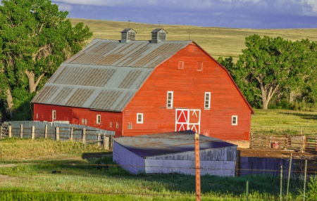 Rural scene of red barn in a countryside setting