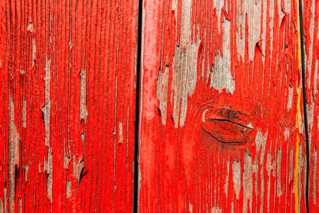 Old peeling red barnwood backdrop with room for copyspace photo