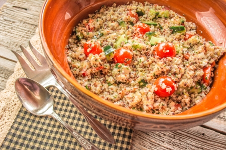 Ancient grain quinoa salad with tomatoes and feta cheese close up