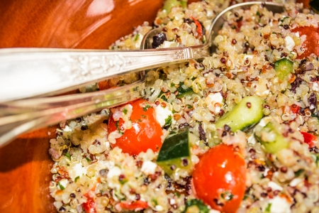 Mediterranean quinoa salad with tomatoes and feta cheese close up