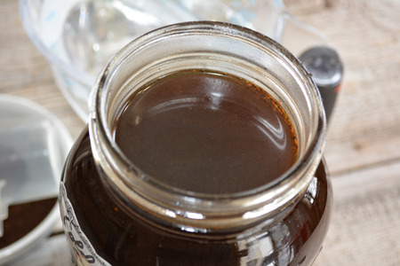 Close-up of jar of cold brewed coffee and grounds