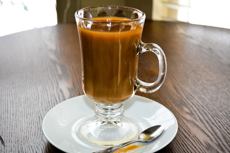 Cold brewed coffee in glass mug on plate Stock Photo