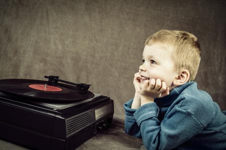 dj boy: boy listening to player