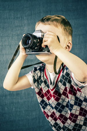 old photograph: boy photographs the old camera