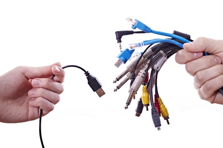 Woman's hand with a usb cable and men with different cables Stock Photo - 11980433