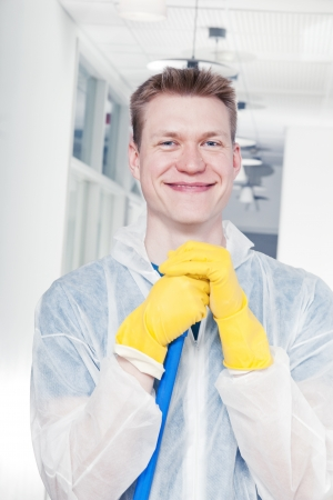 polisher: Smiling cleaner man wearing protective overall