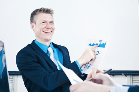 scandinavian people: Businessman in meeting presenting sales report