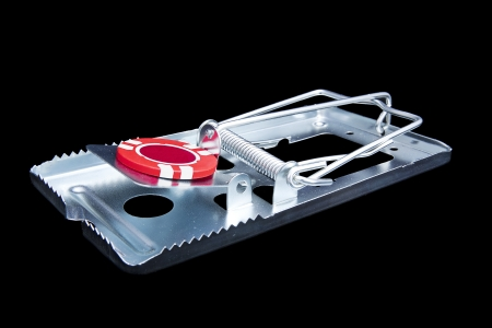 gambling chip: Addiction concept image of risks - mouse trap with gambling chip