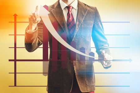 sales chart: Sales success concept with business man pointing chart
