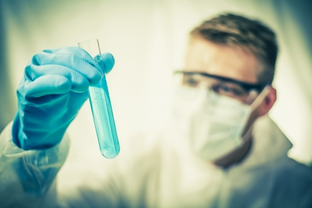 inspecting: Toned picture of chemist inspecting experiment results Stock Photo