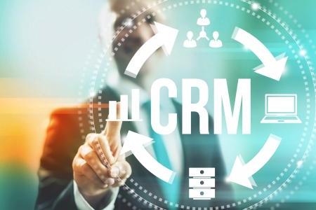 touch screen interface: Customer relationship management concept man selecting CRM Stock Photo