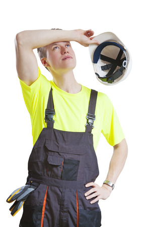 taking a break: Exhausted construction worker taking a break, isolated on white Stock Photo