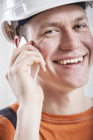 Construction worker talking to mobile phone photo