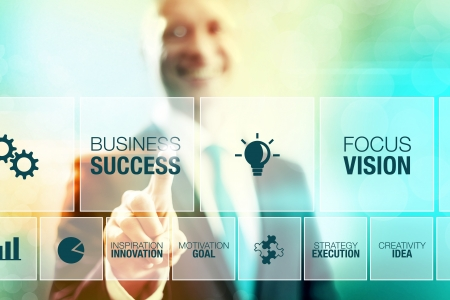 communication concept: Business man selecting success concept pointing interface