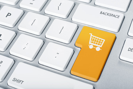 proceed: Online shopping cart proceed concept