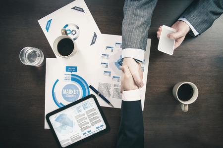 Hand shake at business meeting agreement sales Standard-Bild