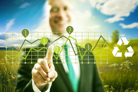 cleantech: Pointing virtual screen green technology charts, clean technology