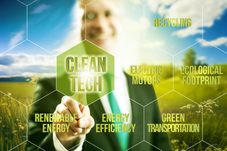 cleantech: Pointing towards camera and pressing virtual screen button clean technology business concept Stock Photo