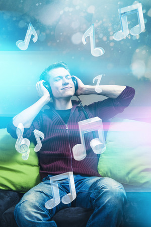 earbud: Listening music with headphones Stock Photo