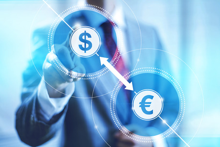 foreign exchange rates: Businessman pointing towards camera selecting currency conversion, virtual interface