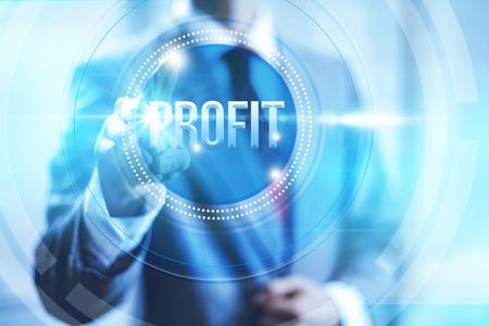 towards: Businessman pointing towards camera selecting profit text, virtual interface Stock Photo