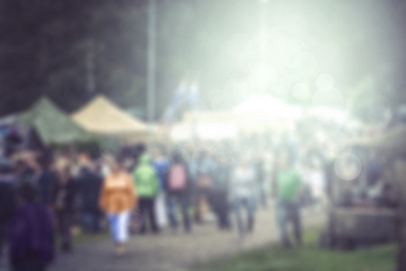 outdoor event: Blurred outdoor festival fair rainy day background