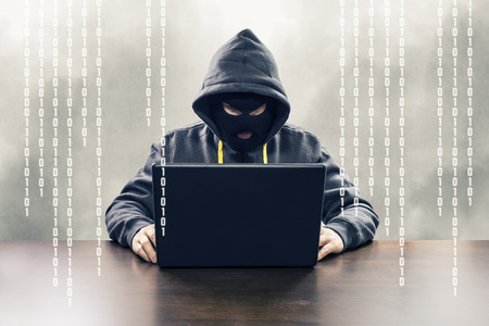 computer services: Masked computer hacker attacking internet services with binary code illustration
