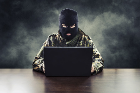 horrors: Masked cyber terrorist in military uniform hacking army intelligence